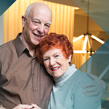 Image of Impella® patient Mary Hanel with her husband on a teal background with a hash pattern overlay