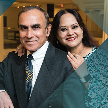 Portrait of Impella patient Babu Eladasari and his wife with a teal background with a hash pattern overlay
