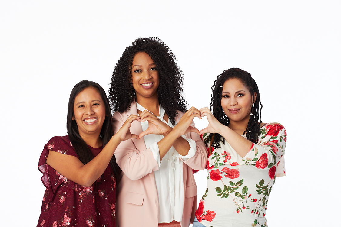 Portrait of three female Impella patients making a heart shape with their hands