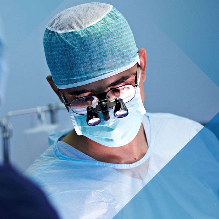 Image of a male surgeon in the operating room with royal blue hash pattern overlay