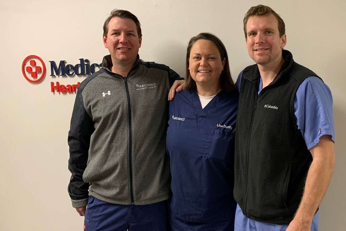 Portrait of three Abiomed employees working in Abiomed clinical services