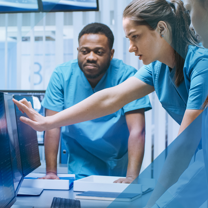 Image of three people in scrubs looking at a computer screen with a blue hash pattern overlay